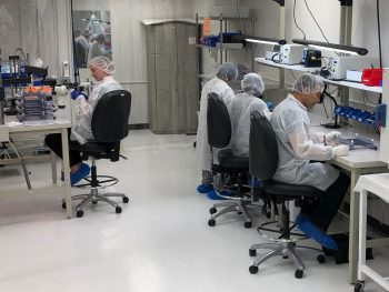 Lab technicians working in a manufacturing setting